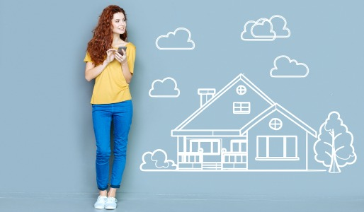 young woman with mobile device house drawing
